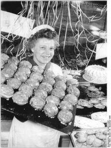 Berliner (Doughnuts) for New Year's Eve.  Courtesy of: Bundesarchiv, Bild 183-43512-0001 / CC-BY-SA under license: http://creativecommons.org/licenses/by-sa/3.0/de/deed.en.