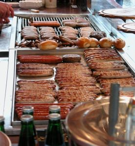 Variety of German Bratwürste on a stand at the Hauptmarkt in Nuremberg; Photo courtesy of: Gerbis under the license: http://creativecommons.org/licenses/by-sa/3.0/deed.en.
