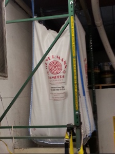 A bag of malt from Bamberg, Germany hangs in the brewery.
